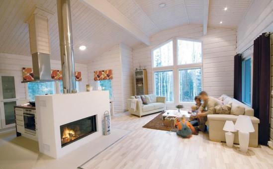 Vaalea koti kylpee luonnonvalossa, eikä tunnelmaa ole haluttu rikkoa liiallisella tavaramäärällä.