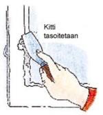 Tasoita kitti teräslastalla tai kittiveitsellä