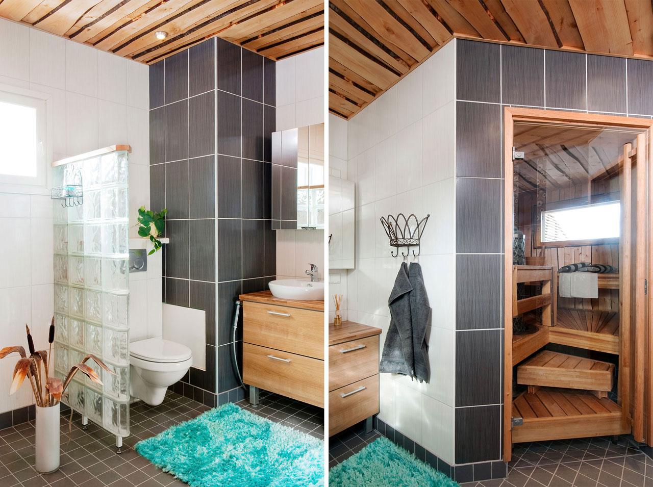 Wc-istuin on erotettu suihkunurkkauksesta lasitiiliseinällä. Kiintokalusteet ja altaat on hankittu Keittiömaailmasta.